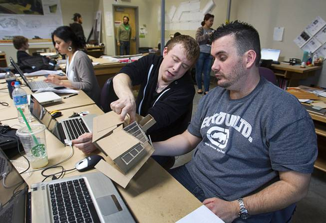 Bryan Oxborrow, left, and Levi Unruh, members of the UNLV Solar Decathlon team, discuss construction details on a study model at the School of Architecture at UNLV Wednesday, Feb. 6, 2013. The solar decathlon is a biennial U.S. Department of Energy-sponsored competition intended to educate the public about energy-saving residential design. UNLV will compete against 19 other schools this October in Irvine, Calif.