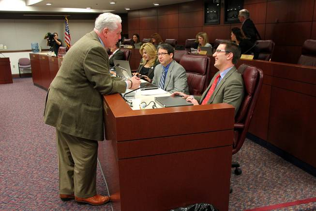 Assemblyman John Hambrick talks with Assembyman Wesley Duncan before a meeting of the Health and Human Services Committee during the third day of the 2013 legislative session Wednesday, Feb. 6, 2013 in Carson City.