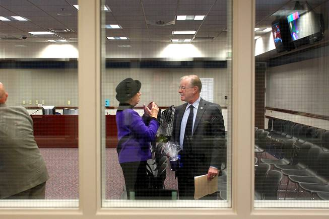 Lobbyist Carole Vilardo talks with Senator David Parks during the third day of the 2013 legislative session Wednesday, Feb. 6, 2013 in Carson City.