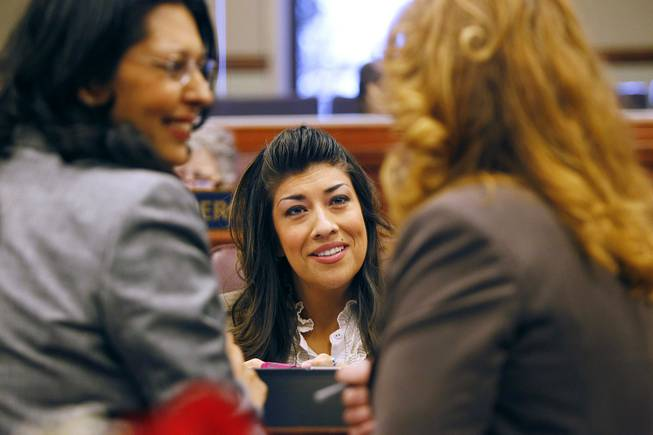 From left, Assemblywomen Olivia Diaz, Lucy Flores and Assembly Speaker Marilyn Fitzpatrick talk before the start of an Assembly session during the third day of the 2013 legislative session Wednesday, Feb. 6, 2013 in Carson City.