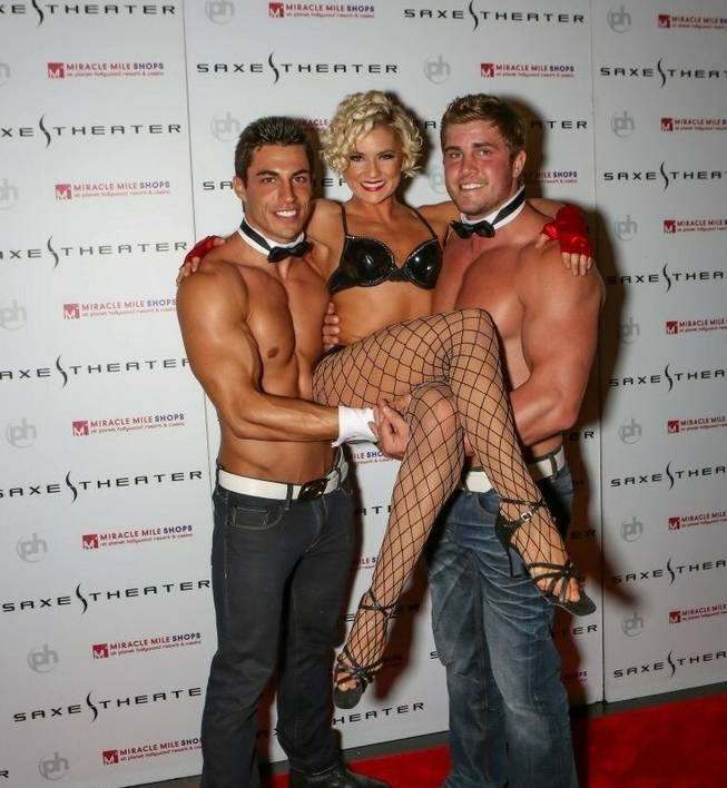 Amy Toliver with Chippendales dancers Jon Howes and Gavin McHale.