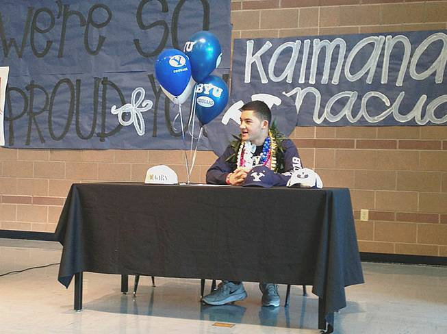 Liberty football player Kai Nacua signed a national letter of intent Wednesday, Feb. 6, in their school's gymnasium. He'll play for Brigham Young University.