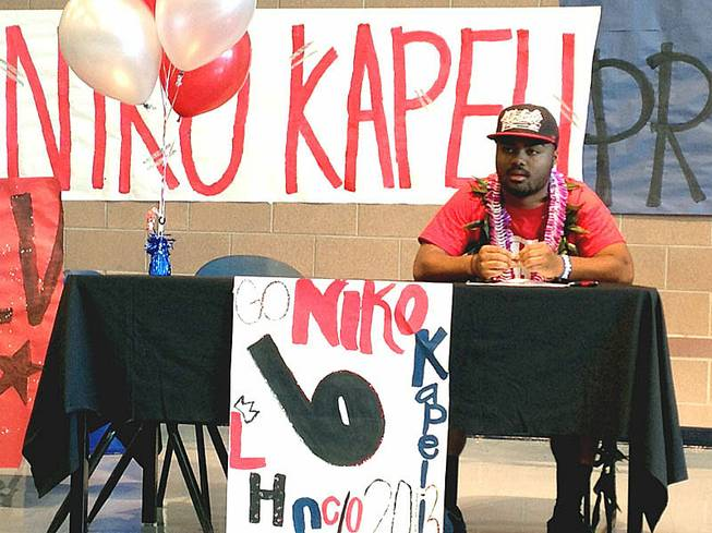 Liberty football player Niko Kapeli signed a national letter of intent Wednesday, Feb. 6, to play for UNLV.