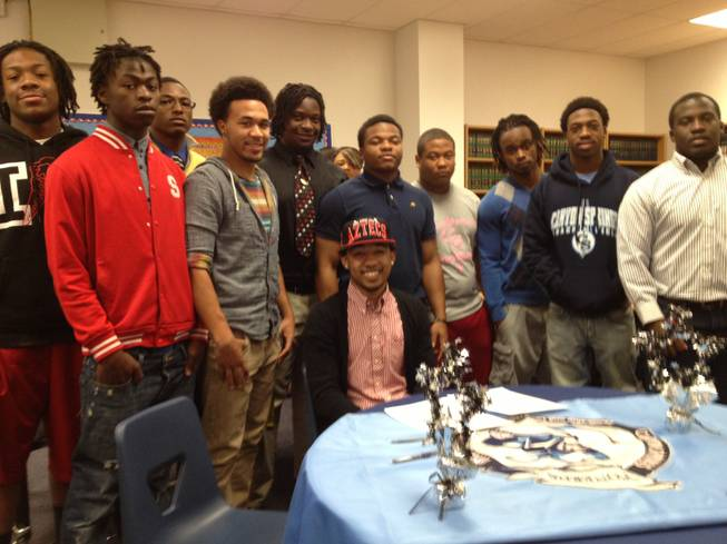 Canyon Springs High's Donnel Pumphrey is joined by teammates after signing his letter-of-intent with San Diego State on Feb. 6, 2013.