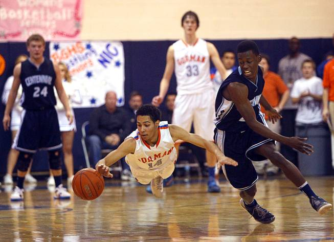 "Awarded second place in ""Best Sports Photo"" category by the Nevada Press Association. Bishop Gorman's Noah Robotham, left, dives for a loose ball during a game against Centennial High School at Bishop Gorman Thursday, Feb. 7, 2013. Centennial's Malcolm Allen is at right. Bishop Gorman beat Centennial 79-71 in double overtime."