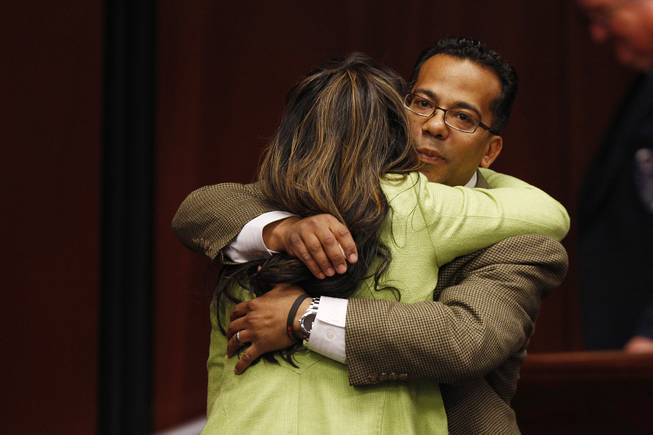 After calling her over, Assemblyman Steven Brooks hugs Assemblywoman Lucy Flores Thursday, Feb. 7, 2013 during the 2013 legislative session in Carson City.