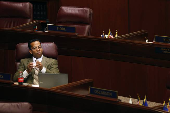 Assemblyman Steven Brooks sits alone after a floor session Thursday, Feb. 7, 2013 during the 2013 legislative session in Carson City. Brooks announced during the session that he would take a leave of absence to address health issues.