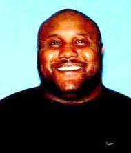 In this image provided by the Irvine, Calif., Police Department, former Los Angeles police officer Christopher Jordan Dorner is shown. A manhunt spread across southern California on Thursday, Feb. 7, 2013, for Dorner, a former Los Angeles police officer, who has threatened to kill police, is being sought in two weekend killings and is a suspect in an overnight shooting that killed one officer and critically wounded another.