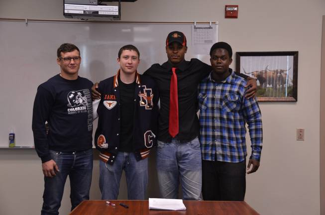 Members of the Legacy High football team are photographed after signing their letters-of-intent. They include: Randy Ricks (San Diego State), Joe Murray (Colorado School of the Mines),  Jake Martin (Coast Guard Academy) and Chris Campbell (Dixie State College).