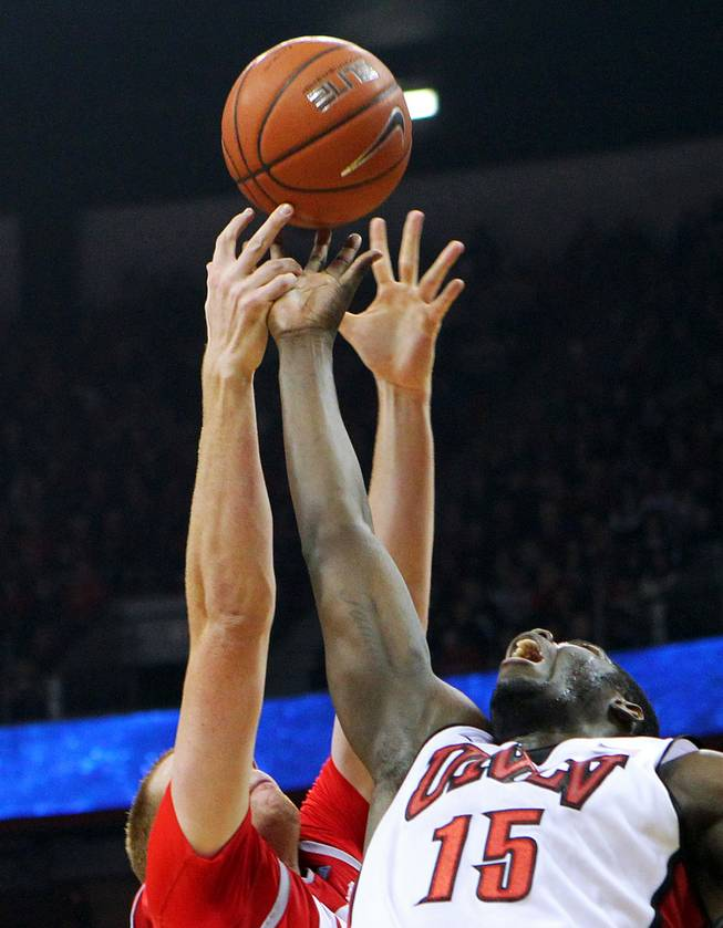 UNLV forward Anthony Bennett and New Mexico center Alex Kirk reach for a rebound during their game Saturday, Feb. 9, 2013 at the Thomas & Mack Center. UNLV beat New Mexico 64-55.
