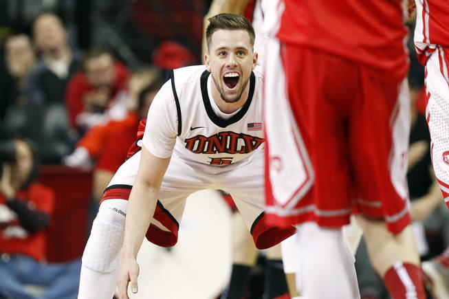 UNLV guard Katin Reinhardt reacts while getting back on defense after sinking a three-point basket against New Mexico Saturday, Feb. 9, 2013 at the Thomas & Mack Center. UNLV beat New Mexico 64-55.