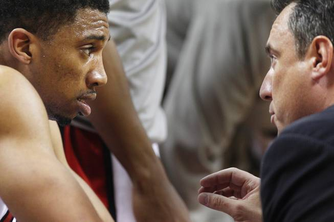 UNLV forward Khem Birch talks to coach Heath Schroyer during their game against New Mexico Saturday, Feb. 9, 2013 at the Thomas & Mack Center. UNLV beat New Mexico 64-55.