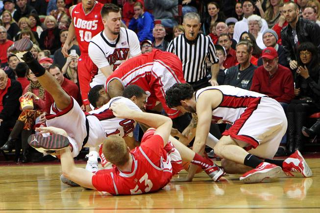 UNLV and New Mexico played chase after a loose ball during their game Saturday, Feb. 9, 2013 at the Thomas & Mack Center. UNLV beat New Mexico 64-55.