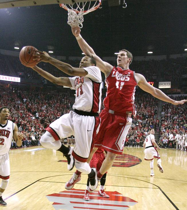 UNLV guard Bryce Dejean-Jones is guarded by New Mexico forward Cameron Bairstow during their game Saturday, Feb. 9, 2013 at the Thomas & Mack Center. UNLV beat New Mexico 64-55.