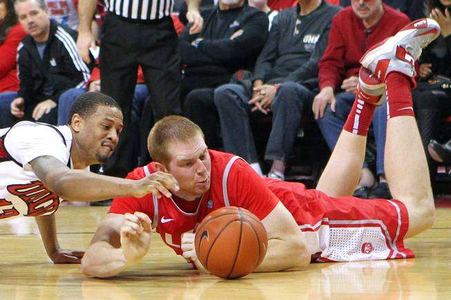 UNLV guard Bryce Dejean-Jones and New Mexico center Alex Kirk chase a loose ball during their game Saturday, Feb. 9, 2013 at the Thomas & Mack Center. UNLV beat New Mexico 64-55.