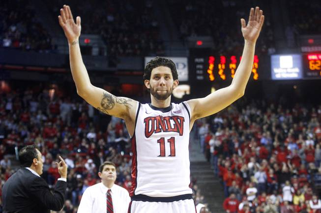 UNLV forward Carlos Lopez-Sosa tries to get the crowd louder during their game against New Mexico Saturday, Feb. 9, 2013 at the Thomas & Mack Center. UNLV beat New Mexico 64-55.