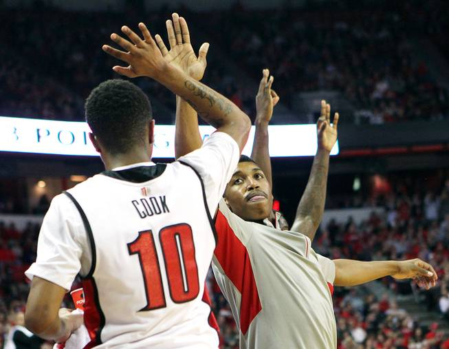 UNLV guard Daquan Cook and Justin Hawkins high five during their game against New Mexico during their game Saturday, Feb. 9, 2013 at the Thomas & Mack Center. UNLV beat New Mexico 64-55.