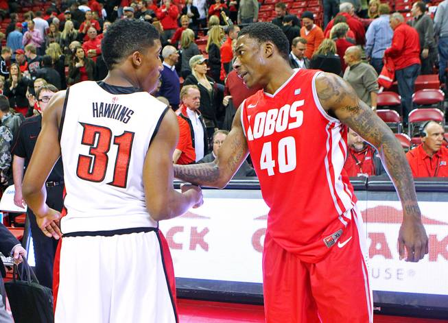 Former AAU teammates, UNLV guard Justin Hawkins and New Mexico guard Demetrius Walker talk after their game Saturday, Feb. 9, 2013 at the Thomas & Mack Center. UNLV beat New Mexico 64-55.