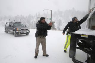 California Highway Patrol officers search a truck for former Los Angeles police officer Christopher Dorner at a checkpoint near Big Bear Lake, Calif., on Friday, Feb. 8, 2013.