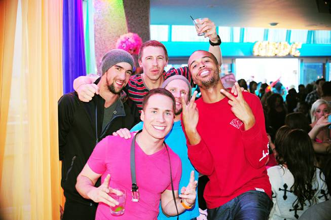 Michael Phelps, left, parties with friends at Ghostbar Dayclub at ...