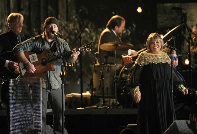 Artists, from left, T-Bone Burnett, Zac Brown, Mavis Staples and Elton John perform at the 55th annual Grammy Awards on Sunday, Feb. 10, 2013, in Los Angeles.