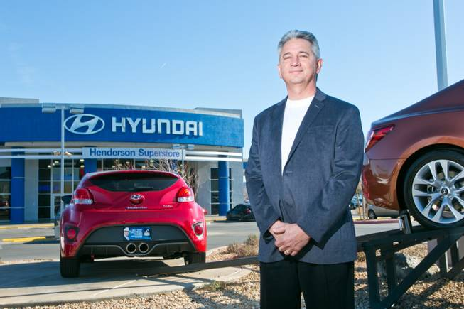 Frank Maione, owner of Henderson Hyundai Superstore, stands on the lot of his dealership, Tuesday, Feb. 12, 2013.
