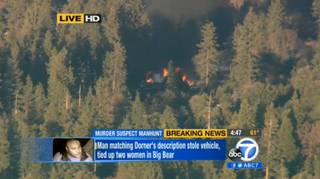 In this image taken from video provided by KABC-TV, the cabin in Big Bear, Calif. where ex-Los Angeles police officer Christopher Dorner is believed to be barricaded inside is in flames Tuesday, Feb. 12, 2013.
