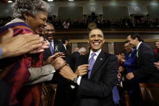 President Barack Obama is greeted before his State of the Union address during a joint session of Congress on Capitol Hill in Washington, Tuesday Feb. 12, 2013.