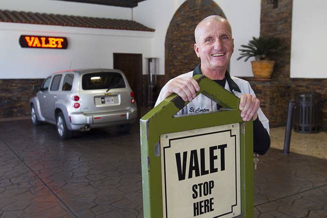 Valet attendant Leo Heffner poses at the porte cochere at the El Cortez in downtown Las Vegas Wednesday, Feb.13, 2013.