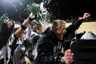 Palo Verde head coach Kevin Hagood is doused with water as the clock expires during their district championship flag football game against  Silverado Wednesday, Feb. 13, 2013. Palo Verde won the game 7-6.