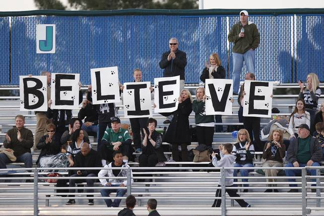 Palo Verde fans hold up a sign during the district championship for flag football against Silverado Wednesday, Feb. 13, 2013. Palo Verde won the game 7-6.