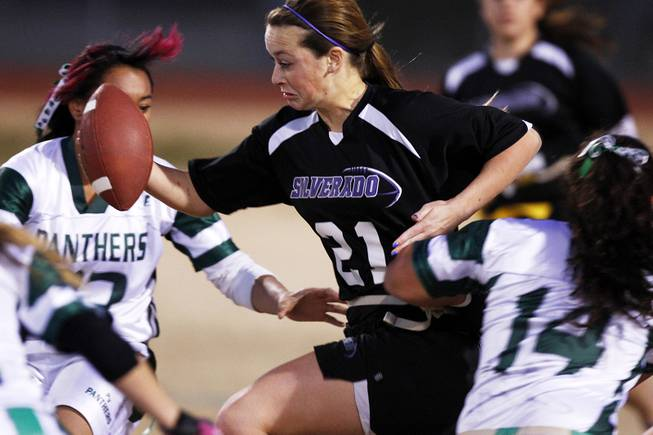 Silverado's Danni Parven tries to break through the Palo Verde defense during the district championship for flag football Wednesday, Feb. 13, 2013. Palo Verde won the game 7-6.