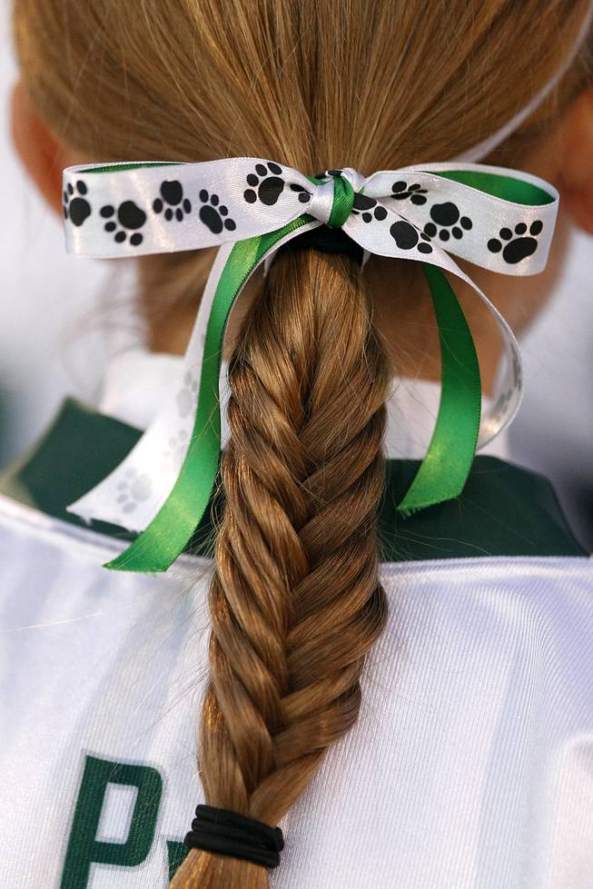 A Palo Verde player wears a ribbon in her braid during the district championship game for flag football against Silverado Wednesday, Feb. 13, 2013. Palo Verde won the game 7-6.