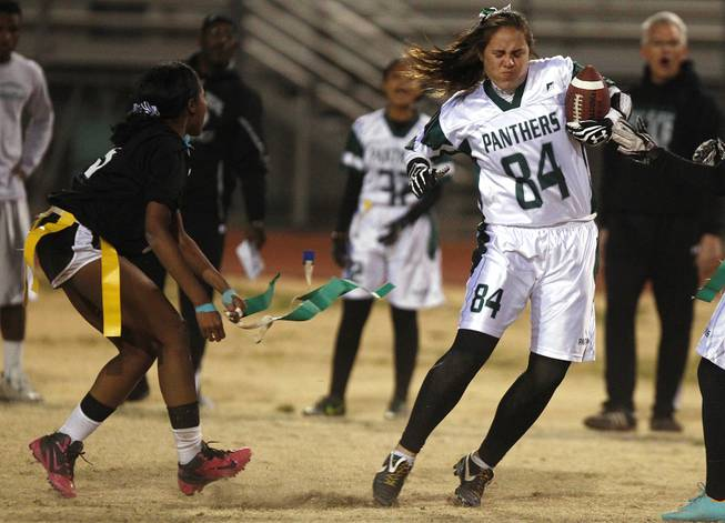 Palo Verde's Sydney Tuiofea is downed by Silverado's LaShayla Peters during the district championship for flag football Wednesday, Feb. 13, 2013. Palo Verde won the game 7-6.