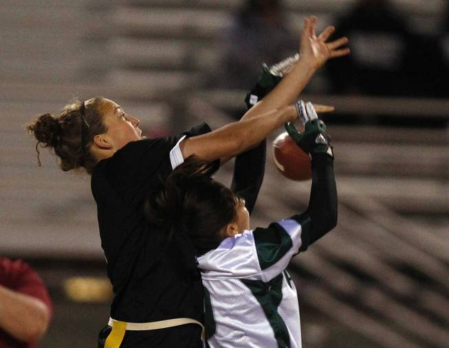 Silverado's Nina Jensen breaks up a pass intended for Palo Verde's Alexa D'Acunto during the district championship for flag football Wednesday, Feb. 13, 2013. Palo Verde won the game 7-6.