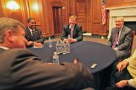 From left to right, Nevada Rep. Steven Horsford, Sen. Dean Heller and Sen. Harry Reid laugh at a joke made by Rep. Mark Amodei, in the foreground, at the first official meeting of the full Nevada congressional delegation in several years, Feb. 13, 2013.