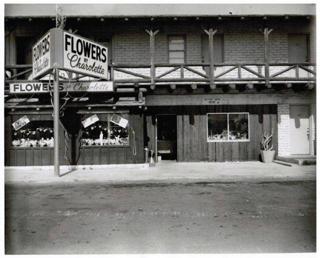 "A black and white photo of Charolette Richard's business ""Flowers by Charolette."""