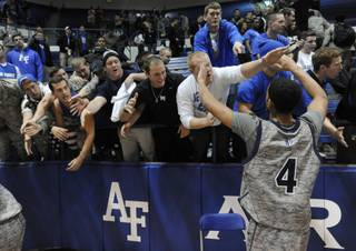 Air Force's Kamryn Williams greets fans Air Force defeated UNLV 71-56 during an NCAA college basketball game Wednesday, Feb. 13, 2013, at Air Force Academy, Colo. (AP Photo/The Gazette, Jerilee Bennett)