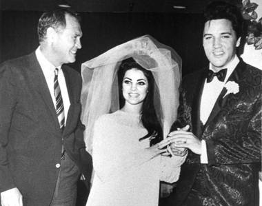 Las Vegas Sun founder Hank Greenspun with Priscilla and Elvis Presley at their wedding May 1, 1967, at the Aladdin Hotel in Las Vegas.