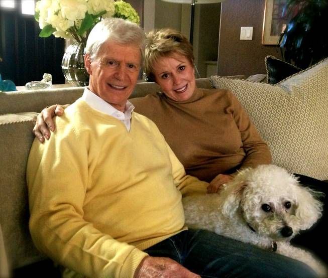Karen and Arthur Pastel; he is 86, she is 67 years old, were married in June 2012. They pose for a photo with their dog Charlie.