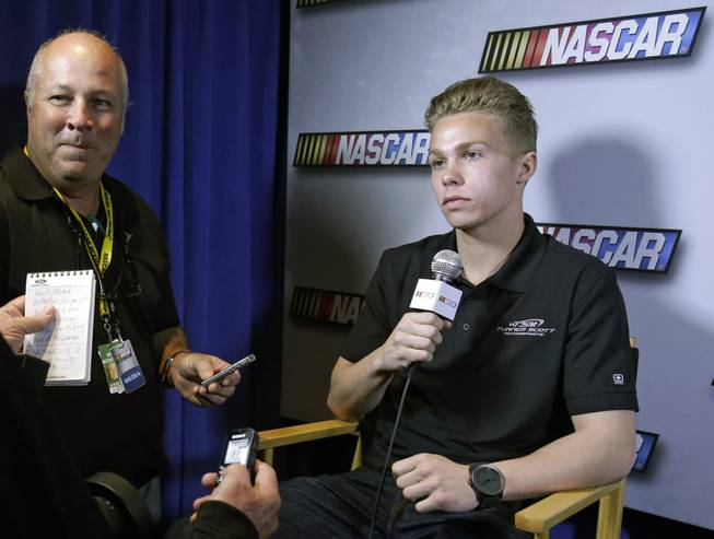 "In this Feb. 14, 2013, auto racing driver Dylan Kwasniewski talks with reporters during NASCAR media day at Daytona International Speedway in Daytona Beach, Fla. Kwasniewski, the youngest driver to ever win the K&N Pro Series West championship, is into action sports, music and everything else that grabs the attention of a typical high school kid. Seizing on opportunity to introduce him to a wider audience and possibly attract a younger demographic, NASCAR co-produced a documentary series on his life on and off the track. The 10 unscripted episodes of ""FLAT OUT"" debuted Tuesday, Sept. 17, 2013, as part of the AOL ON original programming lineup."