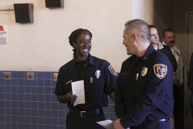 Newly promoted Fire Engineer Jennifer Osborne and  Fire Captain Darren Morville exchange a smile after a ceremony honoring Osborne, Friday, Feb. 15, 2013.  Osborne is the first black female to be promoted to Fire Engineer in the Clark County Fire Department.