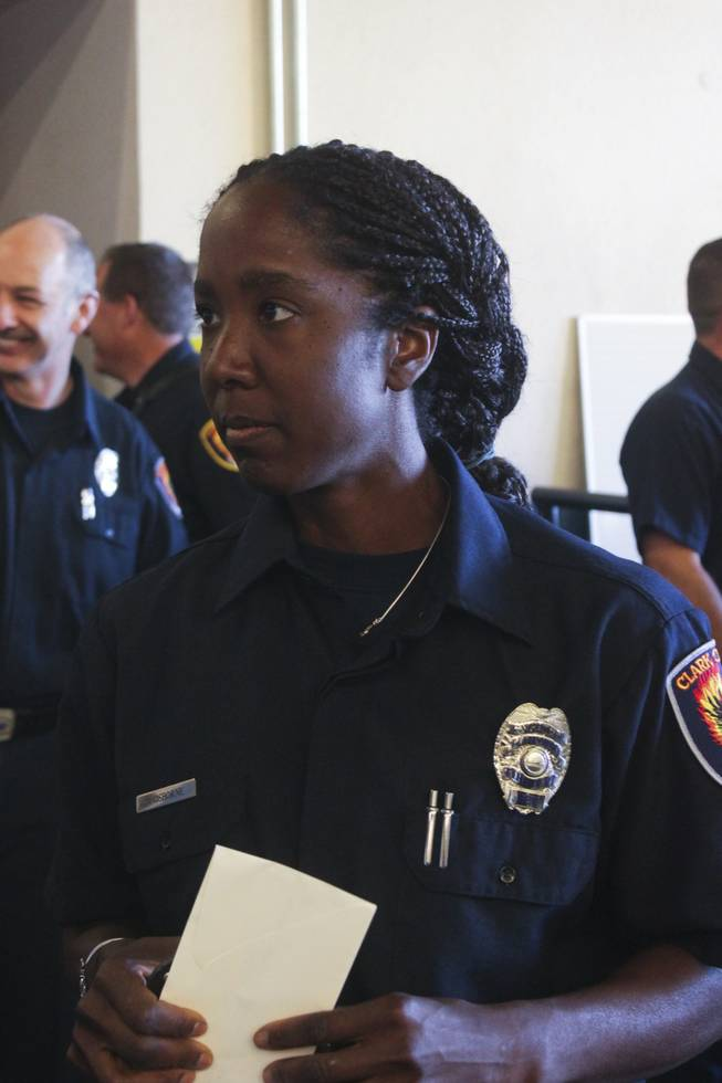 Newly promoted Fire Engineer Jennifer Osborne talks to reporters after a ceremony honoring Osborne, Friday, Feb. 15, 2013. Osborne is the first black female to be promoted to Fire Engineer in the Clark County Fire Department.