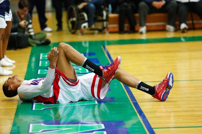 Daniel Young of Valley HS lays on the floor after colliding with another player Friday Feb. 15, 2013. Canyon Springs beat Valley 81 to 74 taking the Sunrise Championship for Division 1.