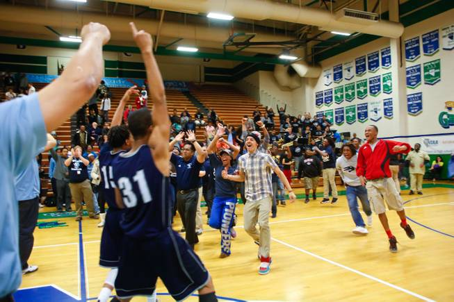 Fans of Canyon Springs rush from the stands to celebrate with their team after beating Valley HS 81 to 74 and taking the Sunrise Championship for Division 1, Friday Feb. 15, 2013.
