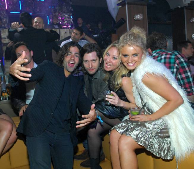 Adrian Grenier, left, parties at Hyde Bellagio on Friday, Feb. ...
