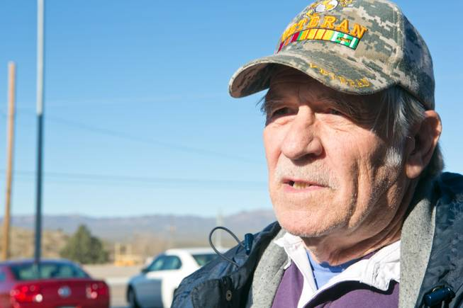 Jim Clay, a Searchlight resident, comments on the upcoming land sale in his town, Friday, Feb. 15, 2013.