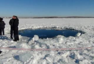 A circular hole in the ice of Chebarkul Lake where a meteor reportedly struck the lake near Chelyabinsk, about 1500 kilometers (930 miles) east of Moscow,  Russia,  Friday, Feb. 15, 2013. A meteor streaked across the sky and exploded over Russias Ural Mountains with the power of an atomic bomb Friday, its sonic blasts shattering countless windows and injuring nearly 1,000 people.