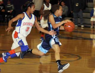 Tramina Jordan dribbles past Gael defender April Rivers as the schools faced off in the Sunset Regional championship game at Durango High School on Friday night.