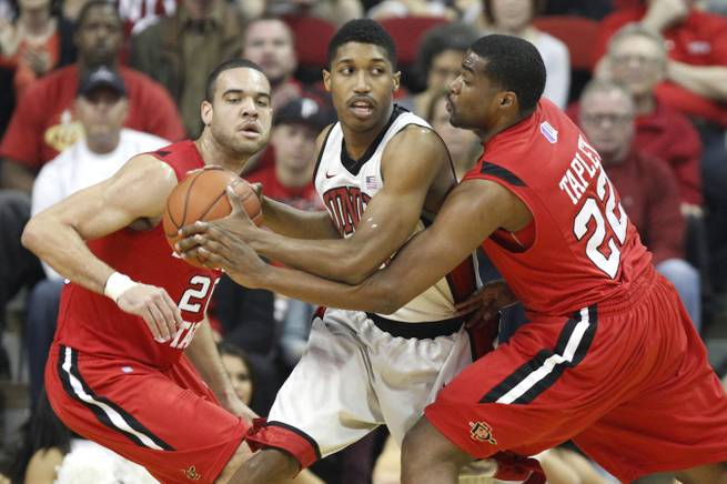 UNLV guard Justin Hawkins is defended by  San Diego State J.J. O'Brien, left, and Chase Tapley during their Mountain West Conference game Saturday, Feb. 16, 2013 at the Thomas & Mack.